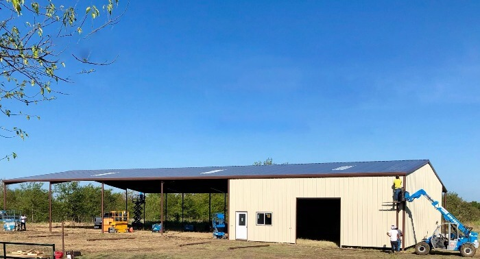 Barn and arena combo under construction by Covered Arena (TM) and Dressage Arenas
