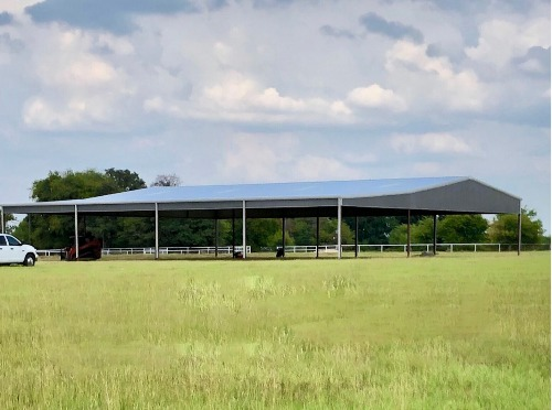 Arena in grass field by Covered Arena (TM) and Dressage Arenas