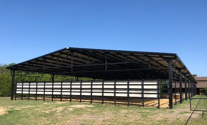 Black arena with riding mirrors by Covered Arena (TM) and Dressage Arenas