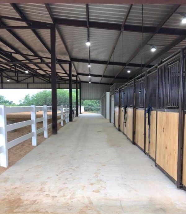 Barn aisle by Covered Arena (TM) and Dressage Arenas
