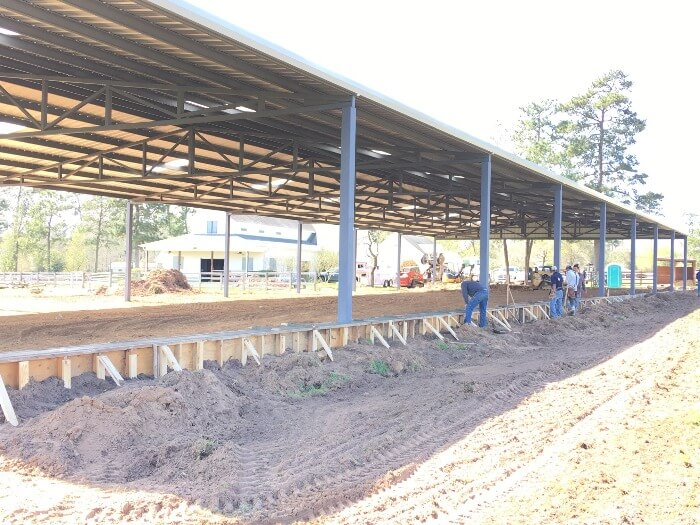 Building arena wall by Covered Arena (TM) and Dressage Arenas