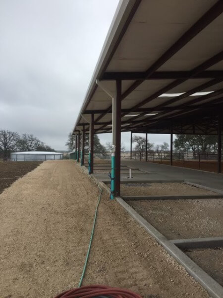 Exterior side under construction by Covered Arena (TM) and Dressage Arenas