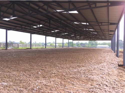 New indoor arena with fluffy footing by Covered Arena (TM) and Dressage Arenas