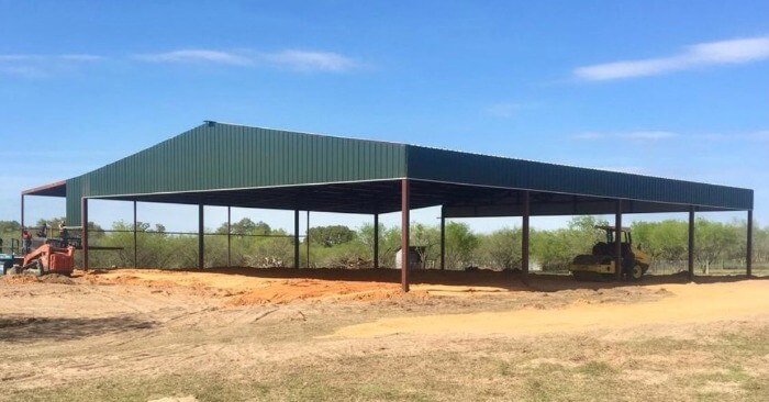 Green arena with overhang by Covered Arena (TM) and Dressage Arenas