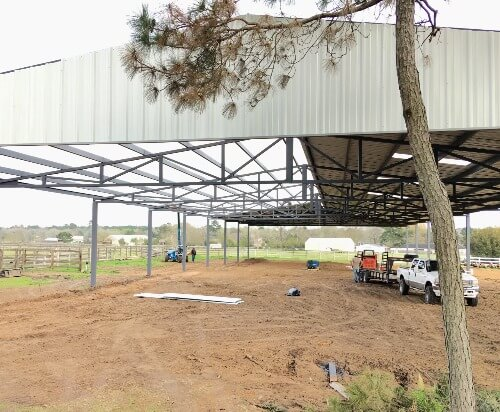 Arena under construction by Covered Arena (TM) and Dressage Arenas
