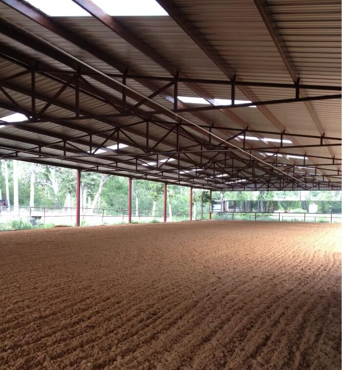 Indoor with skylights by Covered Arena (TM) and Dressage Arenas
