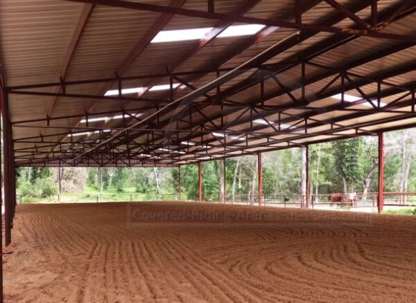 Indoor arena with skylights by Covered Arena (TM) and Dressage Arenas